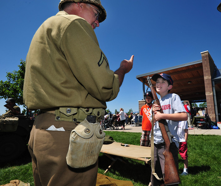 Michael Saunders, 12, holds an M1 rifle listening to Lew Ladwig explain the safety precaustions of handleing a weapon during the Broomfield Veterans Memorial Museum annual Memorial Day Picnic at the Broomfield County Commons.<br /> May 28, 2012 <br /> staff photo/ David R. Jennings