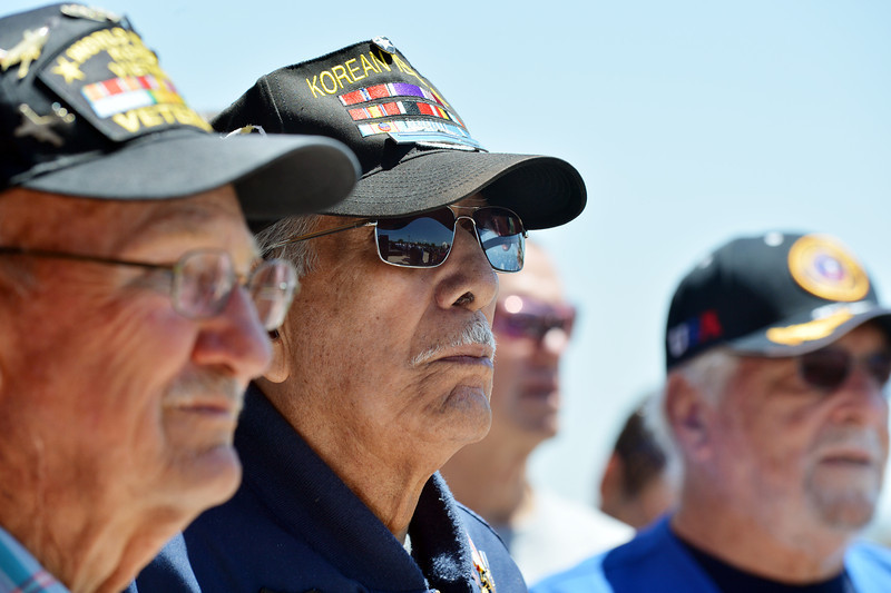 Korean War veteran Lou Barrientos with other veterans stand at attention while the National Anthem is sung the the Broomfied Civic Chorus during the Broomfield Veterans Memorial Museum annual Memorial Day Picnic at the Broomfield County Commons.<br /> May 28, 2012 <br /> staff photo/ David R. Jennings