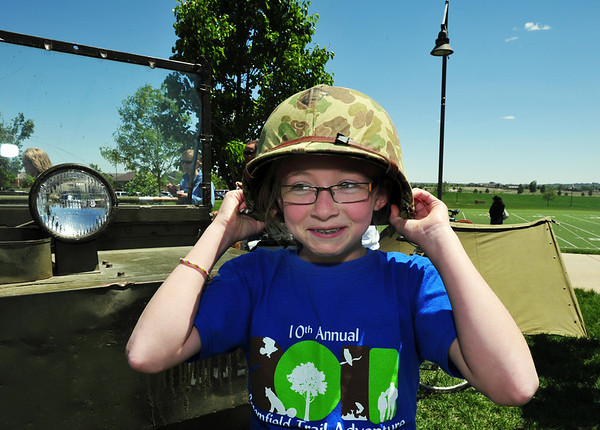 Alexandria Beilfuss, 10, tries on a vintage World War II helmet during the Broomfield Veterans Memorial Museum annual Memorial Day Picnic at the Broomfield County Commons.<br /> May 28, 2012 <br /> staff photo/ David R. Jennings