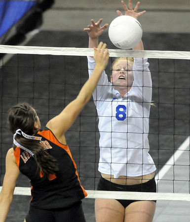 Kimmie Kreeger, Broomfield, blocks a spike by Morgan Griffin,  Lewis-Palmer during the state 4A tournament at the Denver Coliseum on Saturday.<br /> <br /> November 14, 2009<br /> Staff photo/David R. Jennings