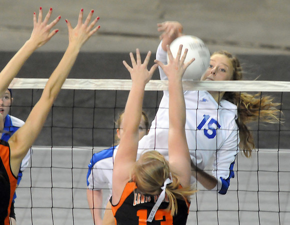 Taylor Frederking, Broomfield, spike the ball past Caitlin Dyche, Lewis-Palmer during the state 4A tournament at the Denver Coliseum on Saturday.<br /> <br /> November 14, 2009<br /> Staff photo/David R. Jennings
