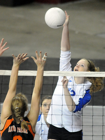 Brianna Fidder, Broomfield, puts the ball over the net past  Christi Limpert, Lewis-Palmer during the state 4A tournament at the Denver Coliseum on Saturday.<br /> <br /> November 14, 2009<br /> Staff photo/David R. Jennings
