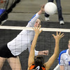 Jordan Sisson, Broomfield, spike the ball against Lewis-Palmer during the state 4A tournament at the Denver Coliseum on Saturday.<br /> <br /> November 14, 2009<br /> Staff photo/David R. Jennings