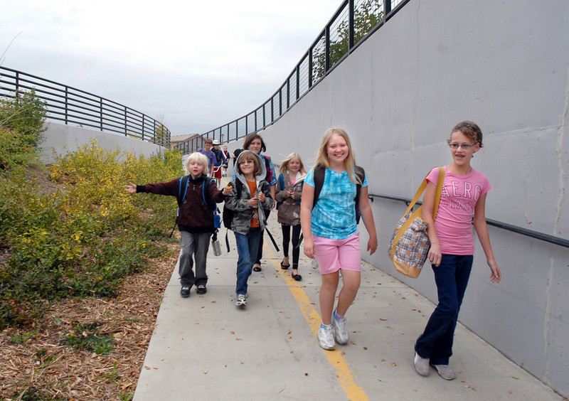 Aspen Creek students walk to the underpass at Aspen St. to the school during Walk to School Day on Wednesday.<br /> <br /> <br /> October 6, 2010<br /> staff photo/David R. Jennings