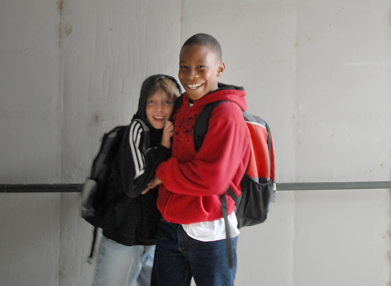 Isaac Sucik, 11, left and Lynn Busby, 10, stop to pose in the Aspen Street pedestrian underpass on their way to Aspen Creek K-8 School for Walk to School Day on Wednesday.<br /> <br /> October 6, 2010<br /> staff photo/David R. Jennings