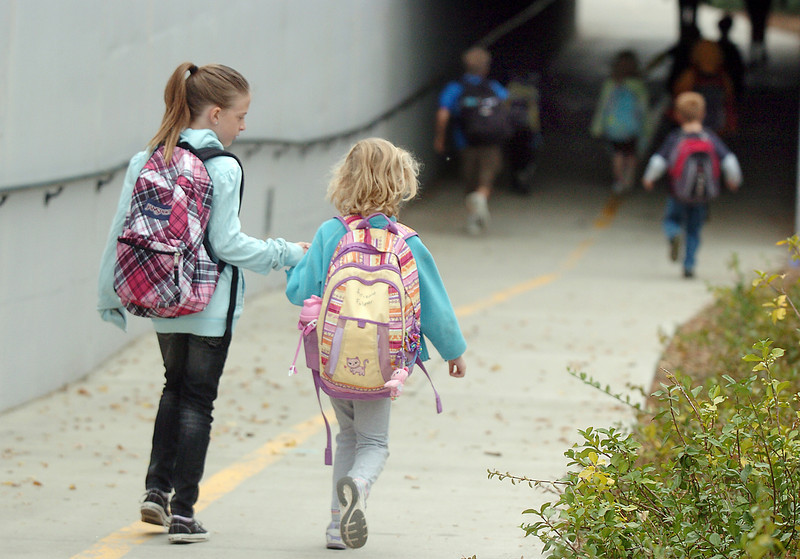 Aspen Creek students walk through the underpass at Aspen St. on their way to the school during Walk to School Day on Wednesday.<br /> <br /> <br /> October 6, 2010<br /> staff photo/David R. Jennings