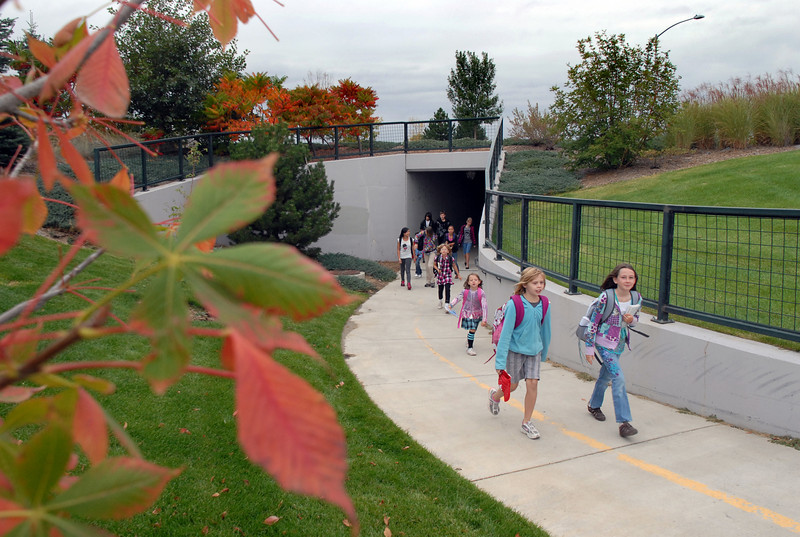 Students from Aspen Creek K-8 School walk through the underpass at Aspen St. for Walk to School Day on Wednesday.<br /> <br /> October 6, 2010<br /> staff photo/David R. Jennings