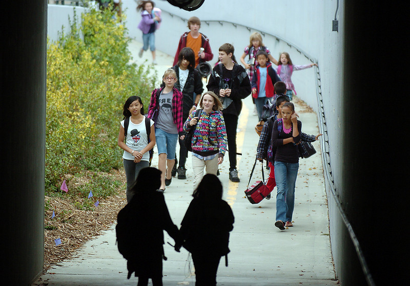 Aspen Creek students, who normally take the bus, walk through the underpass at Aspen St. to the school during Walk to School Day on Wednesday.<br /> <br /> October 6, 2010<br /> staff photo/David R. Jennings