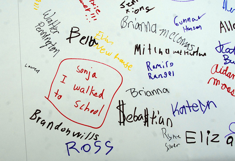 Autographs by Aspen Creek students on the poster for Walk to School Day on Wednesday.<br /> <br /> October 6, 2010<br /> staff photo/David R. Jennings