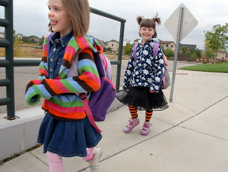 Kylie Pazol, 6, left, and her friend Sophie Steven, 6, walk to Aspen Creek K-8 during Walk to School Day on Wednesday.<br /> <br /> October 6, 2010<br /> staff photo/David R. Jennings
