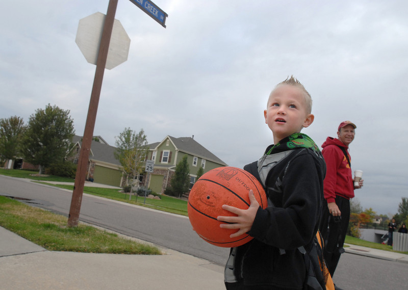 Aiden Mayo, 6, holds his basketball while walking to Aspen Creek K-8 during Walk to School Day on Wednesday.<br /> October 6, 2010<br /> staff photo/David R. Jennings