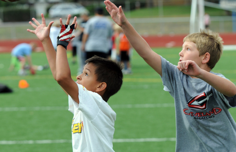 Hayden Nelson, 8, left, and Ryan Ruger, 8, watch a pass during Tuesday's Broomfield High School Youth Football Camp at Elizabeth Kennedy Stadium.<br /> <br /> July 28,2009<br /> staff photo/David Jennings