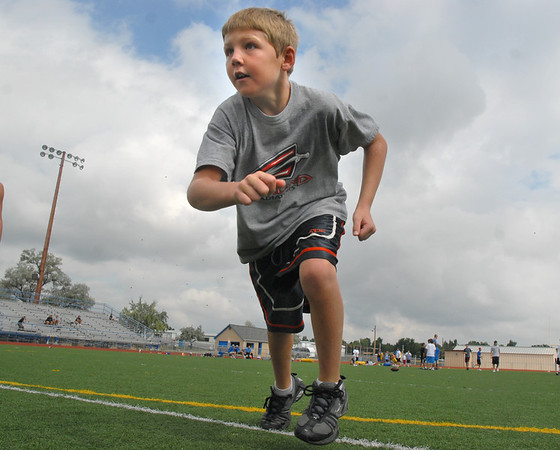 Ryan Ruger, 8, begins running his pass route during Tuesday's Broomfield High School Youth Football Camp at Elizabeth Kennedy Stadium.<br /> <br /> July 28,2009<br /> staff photo/David Jennings