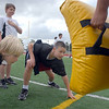 Brendan Hickey, 10, left, and Sam Willett, 10, ready to begin a blocking drill during Tuesday's Broomfield High School Youth Football Camp at Elizabeth Kennedy Stadium.<br /> <br /> July 28,2009<br /> staff photo/David Jennings