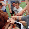 Instructor Sean Gentry, center, leads a motivation high five with the 2nd graders participating in Tuesday's Broomfield High School Youth Football Camp at Elizabeth Kennedy Stadium.<br /> <br /> July 28,2009<br /> staff photo/David Jennings