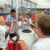 Youth football participants take a water break during Tuesday's Broomfield High School Youth Football Camp at Elizabeth Kennedy Stadium.<br /> <br /> July 28,2009<br /> staff photo/David Jennings
