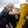 Brendan Hickey, 10, makes a block during Tuesday's Broomfield High School Youth Football Camp at Elizabeth Kennedy Stadium.<br /> <br /> July 28,2009<br /> staff photo/David Jennings