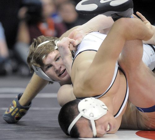 Courtland Hacker, Broomfield,  tries to take control while wrestling Robert DeHerrera, Pueblo South  in the 125lb State 4A Championship match at the Pepsi Center on Saturday.<br /> February 19, 2011<br /> staff photo/David R. Jennings