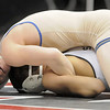 Courtland Hacker, Broomfield,  looks at the clock/scoreboard while wrestling Robert DeHerrera, Pueblo South  in the 125lb State 4A Championship match at the Pepsi Center on Saturday.<br /> February 19, 2011<br /> staff photo/David R. Jennings