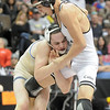 Phil Downing, left, Broomfield,  wrestling Timothy Urenda, Pueblo South  in the 119lb State 4A Championship match at the Pepsi Center on Saturday.<br /> February 19, 2011<br /> staff photo/David R. Jennings