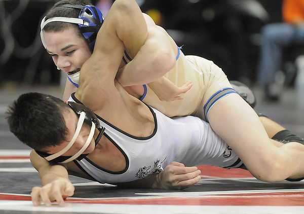 Phil Downing, Broomfield,  wrestling Timothy Urenda, Pueblo South  in the 119lb State 4A Championship match at the Pepsi Center on Saturday.<br /> February 19, 2011<br /> staff photo/David R. Jennings