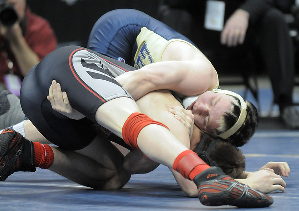 Jesse Carlson, Legacy,  wrestles Justin Frazer, Pomona,  in the 152lb State 5A Championship match at the Pepsi Center on Saturday.<br /> February 19, 2011<br /> staff photo/David R. Jennings