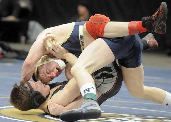Jesse Carlson, Legacy,  pins Justin Frazer, Pomona, to win the 152lb State 5A Championship at the Pepsi Center on Saturday.<br /> February 19, 2011<br /> staff photo/David R. Jennings