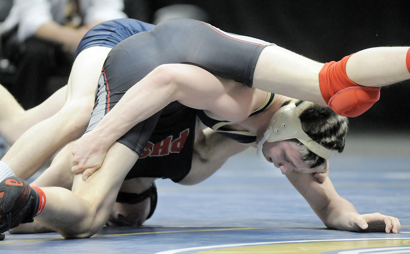 Jesse Carlson, Legacy,  slips from the grasp of  Justin Frazer, Pomona,  in the 152lb State 5A Championship match at the Pepsi Center on Saturday.<br /> February 19, 2011<br /> staff photo/David R. Jennings