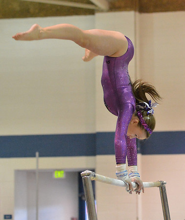 Niwot's Austen Fankhouser performs on the uneven parallel bars during the state individual gymnastics competition at Thornton High School on Saturday.<br /> <br /> November 3, 2012<br /> staff photo/ David R. Jennings