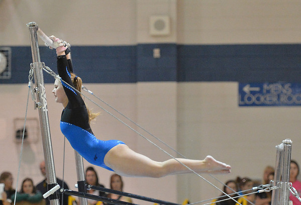 Broomfield's Kailey Licata performs on the uneven parallel bars during the state individual gymnastics competition at Thornton High School on Saturday.<br /> <br /> November 3, 2012<br /> staff photo/ David R. Jennings