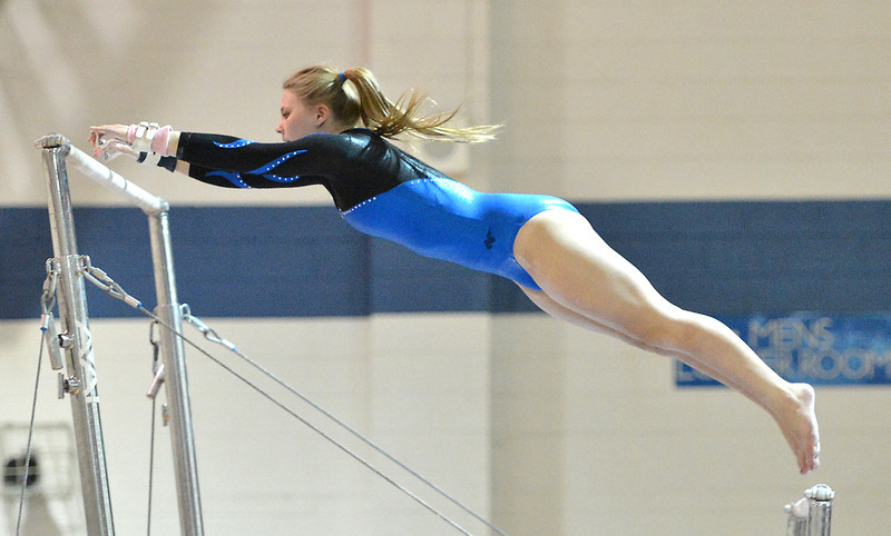 Broomfield's Kailey Licata performs on the uneven parallel bars during the state individual gymnastics competition at Thornton High School on Saturday.<br /> November 3, 2012<br /> staff photo/ David R. Jennings