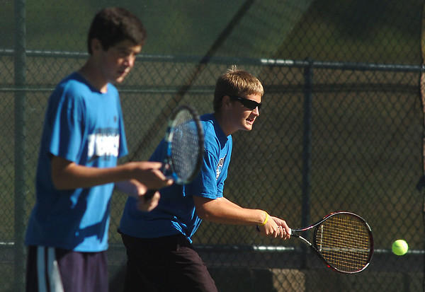 Broomfield's #2 doubles team of Josh Eafanti, left, and Adam Clark playing against Silver Creek's Patrick Sullivan and Scott Baldwin during the regional tennis tournament at the Broomfield Swim and Tennis Club on Thursday.<br /> October 6, 2011<br /> staff photo/ David R. Jennings
