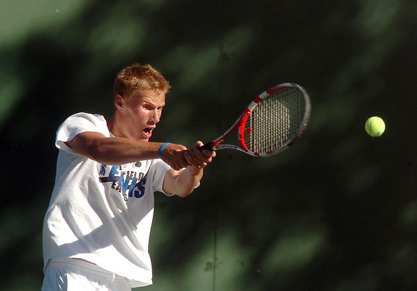 Broomfield's Colin Jensen returns the ball to Silver Creek's Trevor Arrasmith in the the #3 singles match during the regional tennis tournament at the Broomfield Swim and Tennis Club on Thursday.<br /> October 6, 2011<br /> staff photo/ David R. Jennings