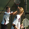 Silver Creek's #2 doubles team of Scott Baldwin, left, and Patrick Sullivan play Broomfield's Adam Clark and Josh Eafanti during the regional tennis tournament at the Broomfield Swim and Tennis Club on Thursday.<br /> October 6, 2011<br /> staff photo/ David R. Jennings