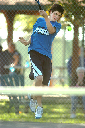Broomfield's Josh Eafanti returns the ball to Silver Creek's  #2 doubles team during the regional tennis tournament at the Broomfield Swim and Tennis Club on Thursday.<br /> October 6, 2011<br /> staff photo/ David R. Jennings