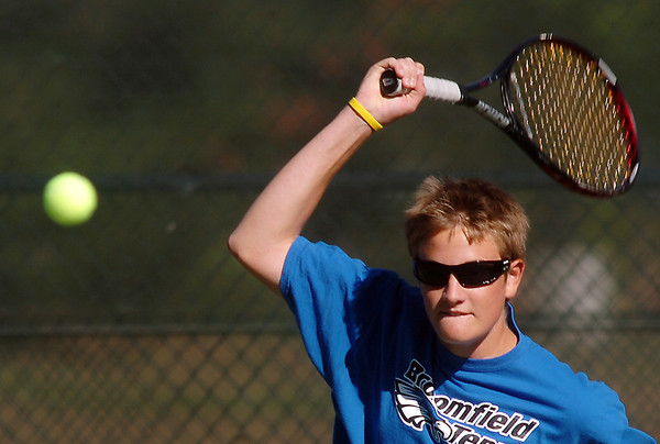 Broomfield's Adam Clark returns the ball to the Silver Creek  #2 doubles team during the regional tennis tournament at the Broomfield Swim and Tennis Club on Thursday.<br /> October 6, 2011<br /> staff photo/ David R. Jennings