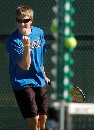 Broomfield's Adam Clark celebrates winning a point against Silver Creek in the #2 doubles match during the regional tennis tournament at the Broomfield Swim and Tennis Club on Thursday.<br /> October 6, 2011<br /> staff photo/ David R. Jennings