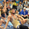 Valor Christian's John Holst, left, celebrates after defeating Broomfield's Jared Albo  in the 152 pound 4A region 3 match at Mullen High School on Saturday.<br /> February 16, 2013<br /> staff photo/ David R. Jennings
