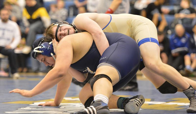 Broomfield's Austin Harris wrestles Mullen's Zach Rios in the 285 pound 4A region 3 match at Mullen High School on Saturday.<br /> February 16, 2013<br /> staff photo/ David R. Jennings