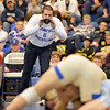 Broomfield's head wrestling coach Joseph Pereira yells instructions to  Jared Albo wrestling Valor Christian's John Holst in the 152 pound 4A region 3 match at Mullen High School on Saturday.<br /> February 16, 2013<br /> staff photo/ David R. Jennings