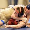 Broomfield's Darek Huff wrestles Elizabeth's Tyler Erzenn the 106 pound 4A region 3 match at Mullen High School on Saturday.<br /> February 16, 2013<br /> staff photo/ David R. Jennings