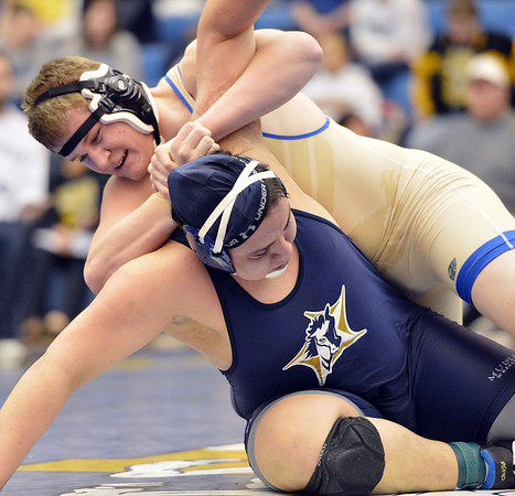 Broomfield's Austin Harris wrestles Mullen's Zach Rios in the 285 pound 4A region 3 match at Mullen High School on Saturday.<br /> February 16, 2013<br /> staff photo/ David R. Jennings