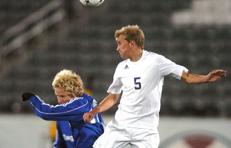 Tim Ayers, Broomfield collides with Dillon Garvin, Air Academy during Wednesday's state 4A championship game at Dick's Sporting Goods Park in Commerce City.<br /> November 10, 2010<br /> staff photo/David R. Jennings