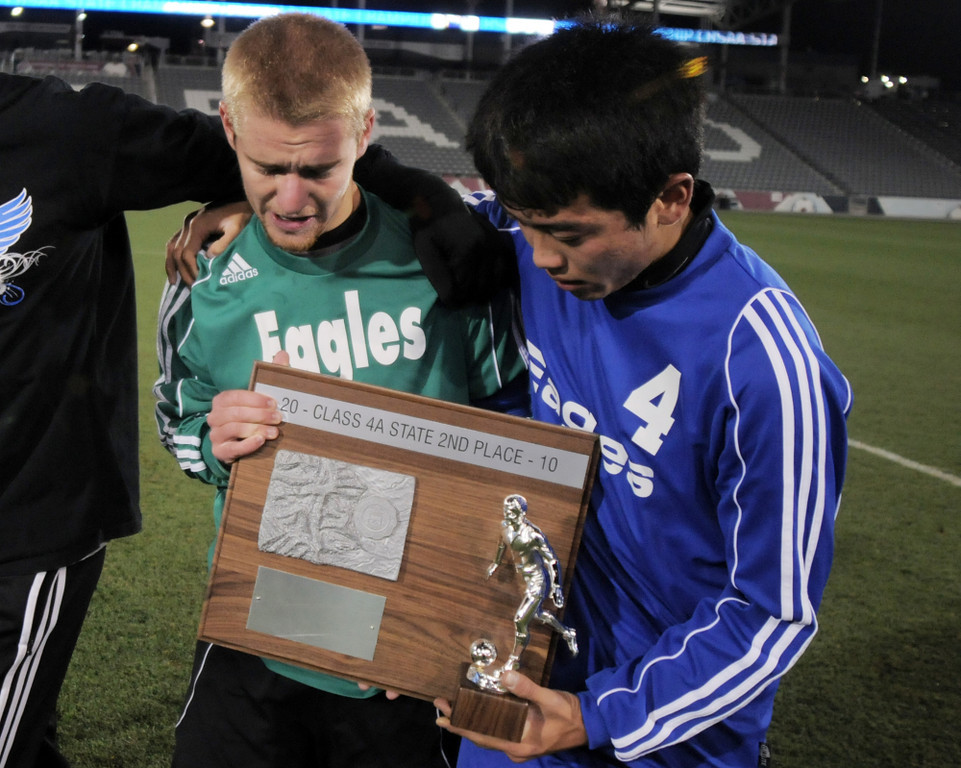 Broomfield's goalie Brendan Buchanan, left, and Alex Tagawa hold the second place trophy after the team lost to Air Academy in Wednesday's state 4A championship game at Dick's Sporting Goods Park in Commerce City.<br /> November 10, 2010<br /> staff photo/David R. Jennings