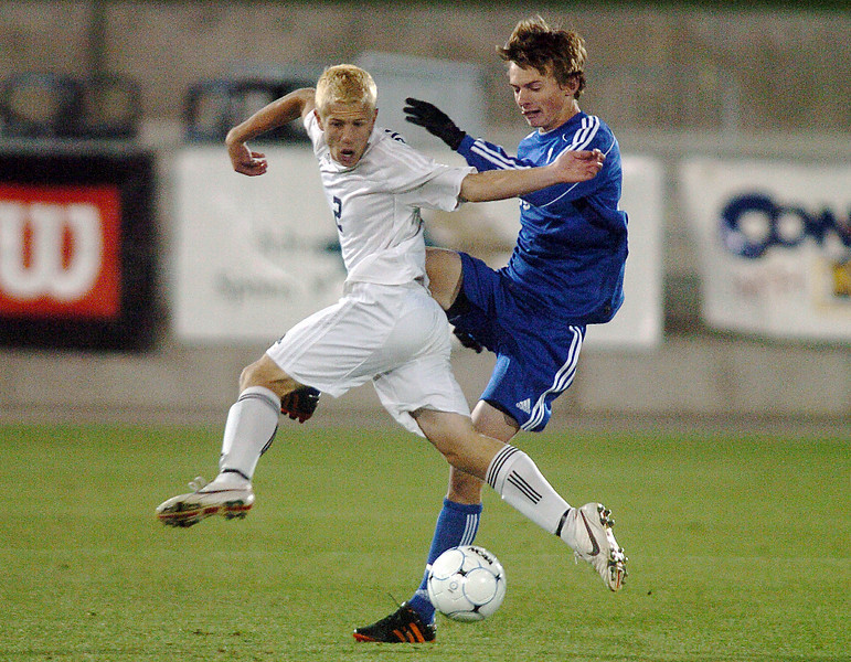 Broomfield's Austin Reece's kick is blocked by Air Academy's Brendan Davis during Wednesday's state 4A championship game at Dick's Sporting Goods Park in Commerce City.<br /> November 10, 2010<br /> staff photo/David R. Jennings
