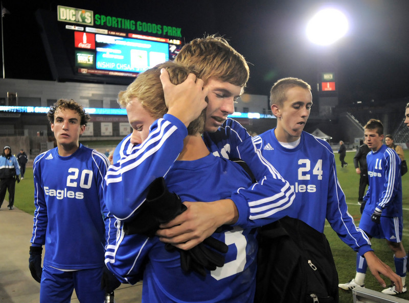 Austin Reece comforts Thomas O'Brien after Broomfield lost to  Air Academy 1-0 at Wednesday's state 4A championship game at Dick's Sporting Goods Park in Commerce City.<br /> November 10, 2010<br /> staff photo/David R. Jennings