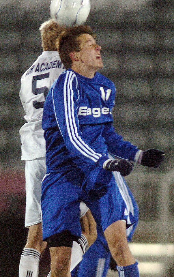 Trevor Sackmann, Broomfield goes for a header against Dillon Garvin,  Air Academy during Wednesday's state 4A championship game at Dick's Sporting Goods Park in Commerce City.<br /> November 10, 2010<br /> staff photo/David R. Jennings