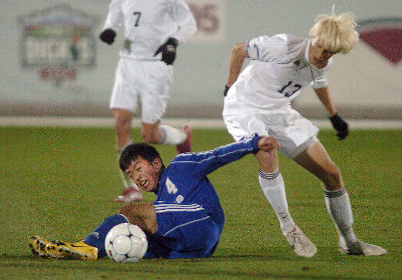 Alex Tagawa, Broomfield tries to keep the ball from Ryan Dozier, Air Academy during Wednesday's state 4A championship game at Dick's Sporting Goods Park in Commerce City.<br /> November 10, 2010<br /> staff photo/David R. Jennings