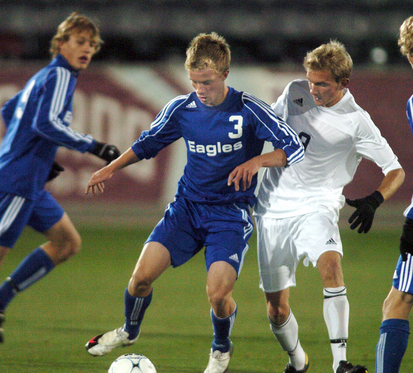 Thomas O'Brien,  Broomfield keeps the ball away from Jack Schultz, Air Academy during Wednesday's state 4A championship game at Dick's Sporting Goods Park in Commerce City.<br /> November 10, 2010<br /> staff photo/David R. Jennings