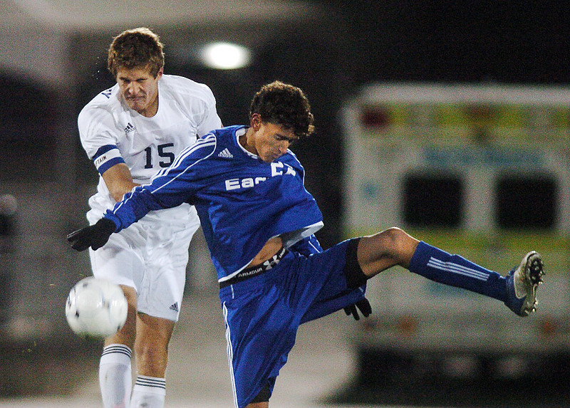 Colton Lamb, Broomfield collides with Mark Dotseth, Air Academy during Wednesday's state 4A championship game at Dick's Sporting Goods Park in Commerce City.<br /> November 10, 2010<br /> staff photo/David R. Jennings